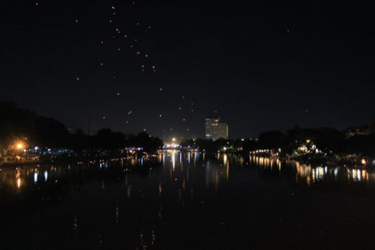 Lanterns floating high above Chiang Mai and the Ping River