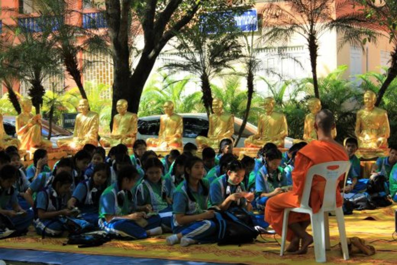 Schoolchildren learning from the resident monks on a field trip