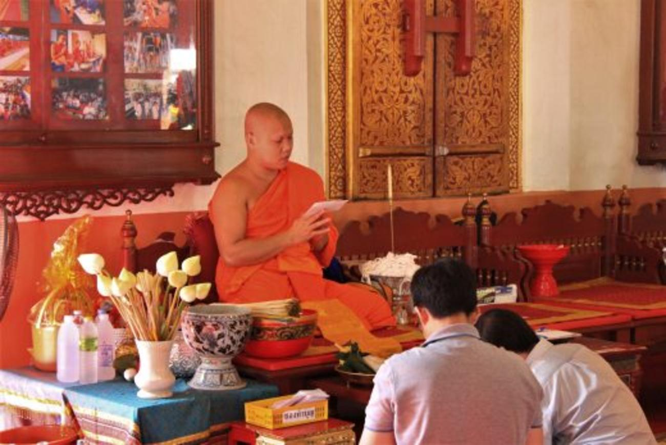 A monk giving this couple a blessing for Loi Krathong